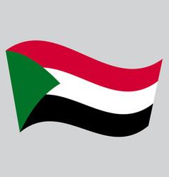 Flag of sudan waving on gray background vector