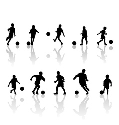Children football silhouettes vector