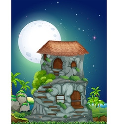 Nature scene of stone house at night vector