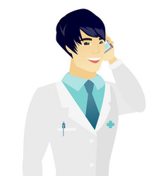 Young asian doctor talking on a mobile phone vector