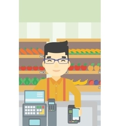 Customer paying wireless with smartphone vector