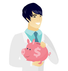Young asian doctor holding a piggy bank vector