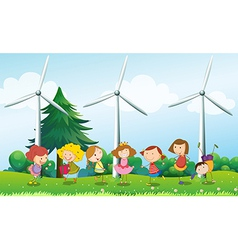 Seven kids playing in the hill with three vector image