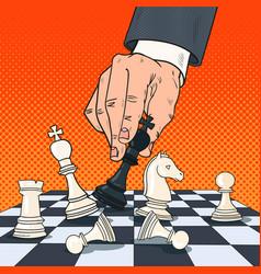 Pop art hand of businessman holding chess figure vector