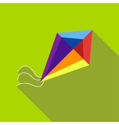 A child s toy a kite on a bright green background vector