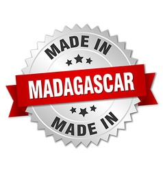 Made in madagascar silver badge with red ribbon vector