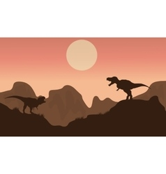 Silhouette of t-rex in cliff with sun vector