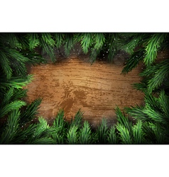 Christmas pine wreath on wooden background vector image