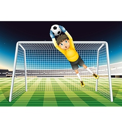 A boy catching the soccer ball vector image