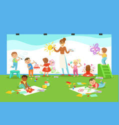 Young children in art class drawing and painting vector