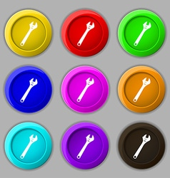 Wrench icon sign symbol on nine round colourful vector