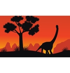 Silhouette of brachiosaurus on the hill vector