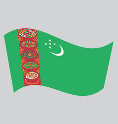 Flag of turkmenistan waving on gray background vector