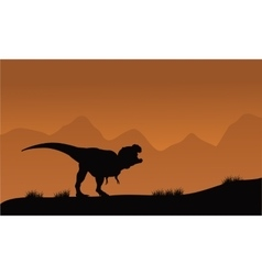 Silhouette of T-Rex in the fields vector image vector image