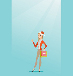 Woman in santa hat shopping for christmas gifts vector