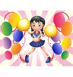 A lively cheerer with her yellow pompoms vector image