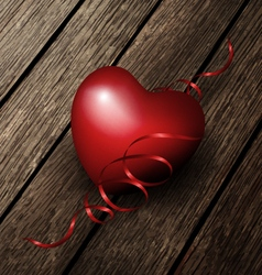 Red heart on a wood boards vector
