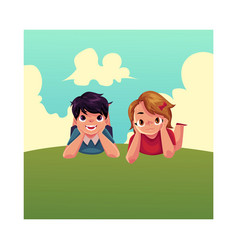 Two caucasian kids children lying on grass under vector