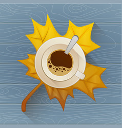 coffee cup on the autumn fall leaves and wooden vector image