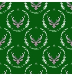Reindeer on a green background seamless pattern vector