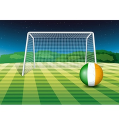 A ball at the field with the flag of Ireland vector image
