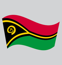 Flag of vanuatu waving on gray background vector