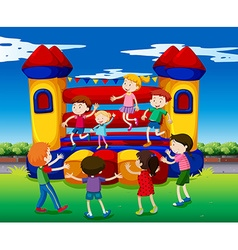 Kids bouncing on the playhouse vector