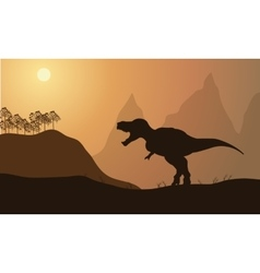Silhouette of tyrannosaurus in fields vector