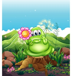 A monster with a flower standing above the stump vector image