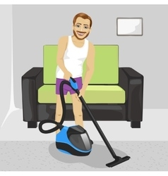 Young man cleaning carpet with vacuum cleaner vector