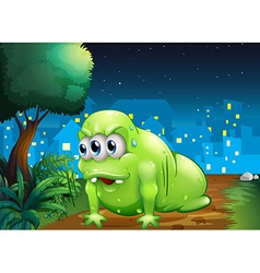 A green monster crawling at the ground in the city vector