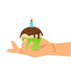 hand holding cupcake with candle vector image vector image