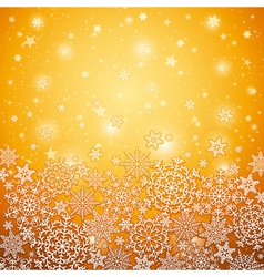 Golden background with snowflakes vector