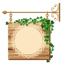 Wooden sign with ivy vector
