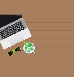 Laptop sun glasses and mojito vector
