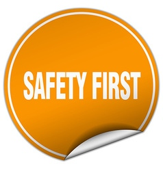 Safety first round orange sticker isolated on vector
