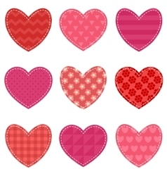 Set of red and pink hearts vector image