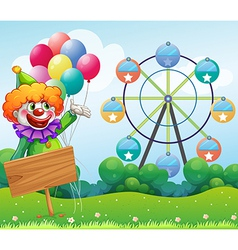 A clown with balloons at the back of an empty vector image vector image
