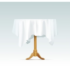 Empty wood round table with tablecloth vector