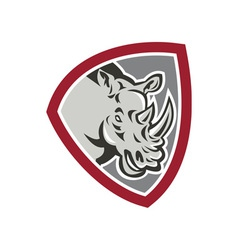 Rhinoceros head side shield vector