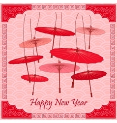 Traditional chinese red umbrellas vector