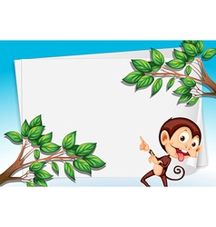 A monkey pointing the empty paper vector image