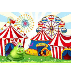 A carnival with a green three-eyed monster vector
