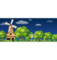 Girl and windmill vector image vector image