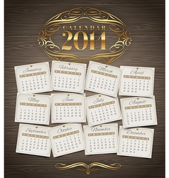 Calendar of 2014 with golden decor vector