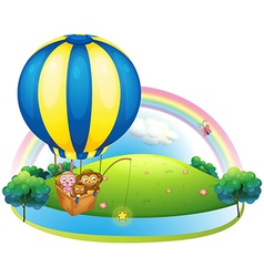 A hot air balloon with three animals vector image