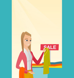 Young woman choosing clothes in the shop on sale vector