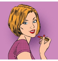 Beautiful girl paints her lips red lipstick pop vector image