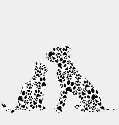 silhouettes of cat and dog in paws pattern vector image vector image