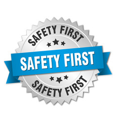 Safety first 3d silver badge with blue ribbon vector